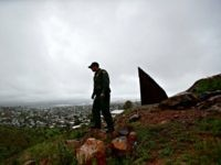 Border Patrol agent Vincent Pirro looks on near where a border wall ends that separates the cities of Tijuana, Mexico, left, and San Diego, Tuesday, Feb. 5, 2019, in San Diego. President Donald Trump is expected to speak about funding for a wall along the U.S.-Mexico border during his State …
