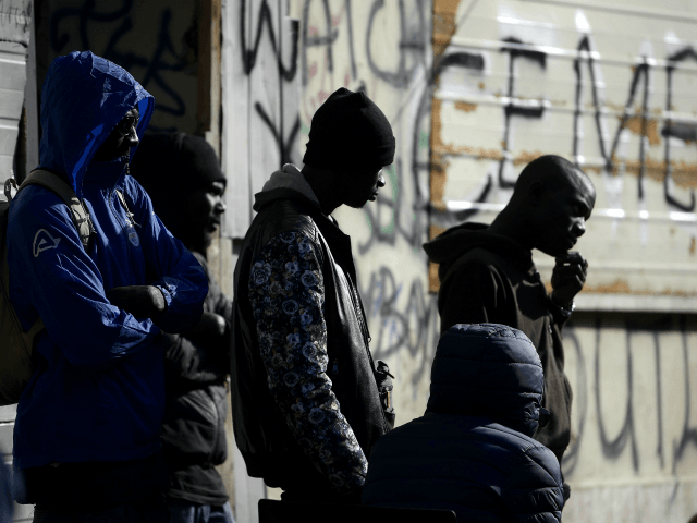Migrants are pictured in a squatted abandoned penicillin factory on November 14, 2018 in Rome's Tiburtina district, where hundreds of migrants live in precarious conditions. - Migrants addressed the media during a press conference in the building on November 14, a day after police on November 13 bulldozed a symbolic …