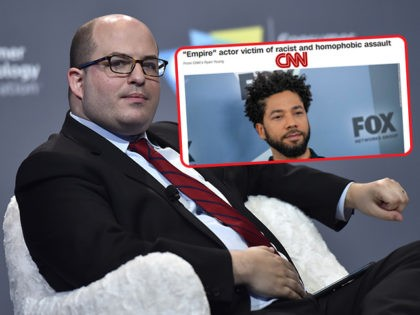 (INSET: CNN headline on Jussie Smollett) LAS VEGAS, NEVADA - JANUARY 09: CNN anchor and correspondent Brian Stelter speaks during a press event at CES 2019 at the Aria Resort