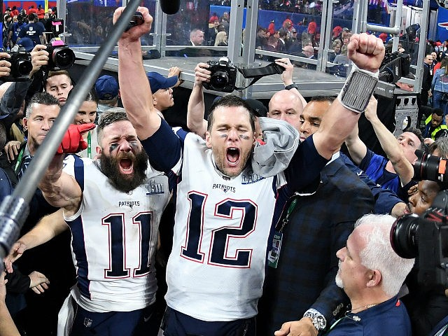 ATLANTA, GA - FEBRUARY 03: Julian Edelman #11 of the New England Patriots and teammate Tom Brady #12 celebrate at the end of the Super Bowl LIII at Mercedes-Benz Stadium on February 3, 2019 in Atlanta, Georgia. The New England Patriots defeat the Los Angeles Rams 13-3. (Photo by Harry …