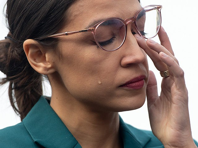 US Representative Alexandria Ocasio-Cortez, Democrat of New York, sheds a tear during a press conference calling on Congress to cut funding for US Immigration and Customs Enforcement (ICE) and to defund border detention facilities, outside the US Capitol in Washington, DC, February 7, 2019. (Photo by SAUL LOEB / AFP) …