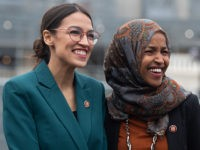 US Representative Alexandria Ocasio-Cortez, Democrat of New York, and US Representative Ilhan Omar (R), Democrat of Minnesota, attend a press conference calling on Congress to cut funding for US Immigration and Customs Enforcement (ICE) and to defund border detention facilities, outside the US Capitol in Washington, DC, February 7, 2019. …