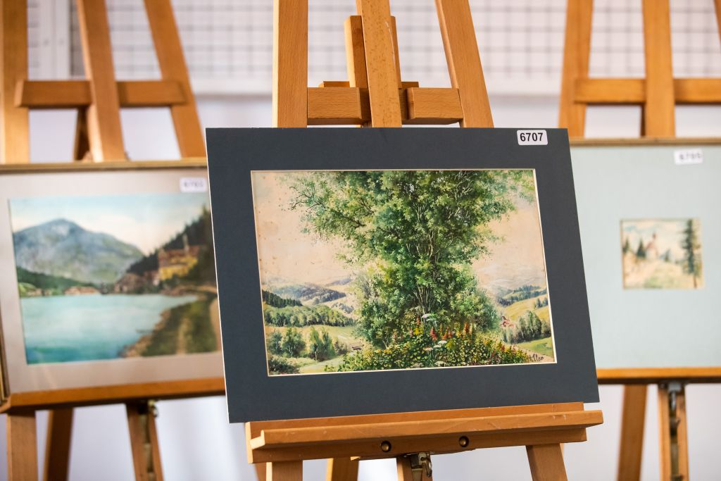 "A picture taken on February 8, 2019 shows the watercolour entitled ""Buschgruppe"" (bush group) signed ""A. Hitler"", which is on display at the Weidler auction house in the southern city of Nuremberg. - A German auction house scrapped the planned sale of 26 artworks attributed to Adolf Hitler, after doubts emerged about their authenticity just days before they were due to go under the hammer. Five paintings signed ""A. Hitler"", all of them watercolours, will be auctioned off on February 9, 2019 as scheduled, according to the Weidler auction house. (Photo by DANIEL KARMANN / AFP) / RESTRICTED TO EDITORIAL USE - TO ILLUSTRATE THE EVENT AS SPECIFIED IN THE CAPTION (Photo credit should read DANIEL KARMANN/AFP/Getty Images)"