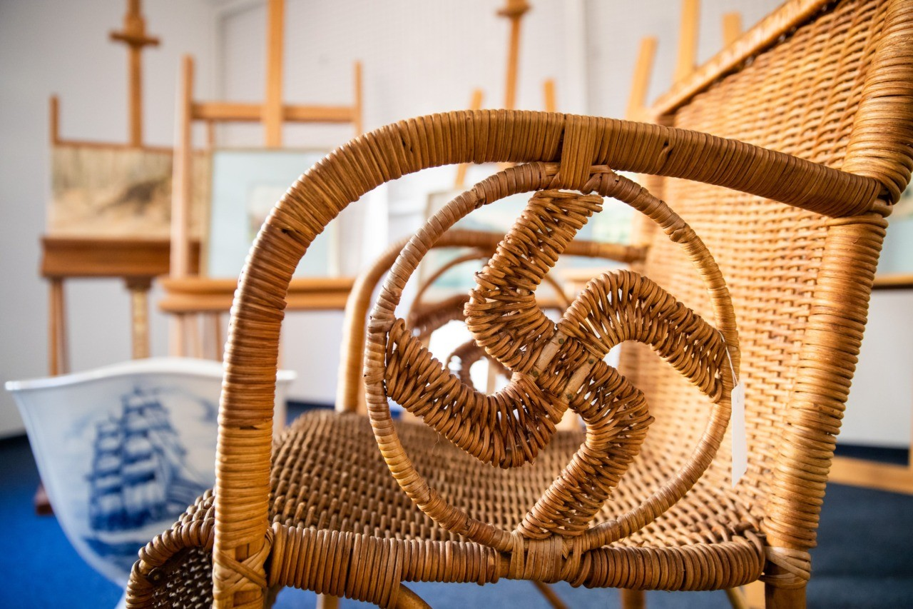 "A picture taken on February 8, 2019 at the Weidler auction house in the southern German city of Nuremberg shows a detail of a wicker armchair bearing a swastika which is presumed to have belonged to the late Nazi dictator Adolf Hitler. - A German auction house scrapped the planned sale of 26 artworks attributed to Adolf Hitler, after doubts emerged about their authenticity just days before they were due to go under the hammer. Five paintings signed ""A. Hitler"", all of them watercolours, will be auctioned off on February 9, 2019 as scheduled, according to the Weidler auction house. (Photo by DANIEL KARMANN / AFP) (Photo credit should read DANIEL KARMANN/AFP/Getty Images)"