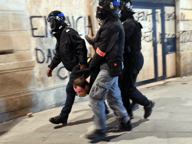 Policemen arrest a protester during an anti-government protest called by the yellow vests movement (Gilets jaunes), on February 9, 2019 in Bordeaux, during the 13th consecutive Saturday of demonstrations. - The 'Yellow Vest' (Gilets Jaunes) movement in France originally started as a protest about planned fuel hikes but has morphed …