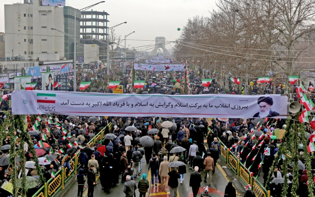 Iranians march towards Azadi (Freedom) Square during a ceremony celebrating the 40th anniversary of Islamic Revolution in the capital Tehran on February 11, 2019. (Photo by ATTA KENARE / AFP) (Photo credit should read ATTA KENARE/AFP/Getty Images)
