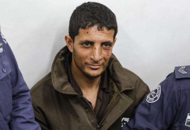 Arafat Irfaiya, a 29-year-old Palestinian suspected of killing a young Israeli woman, is seen in Israeli custody at the Magistrate's Court in Jerusalem on February 11, 2019. - The body of 19-year-old Ori Ansbacher was found on February 7 south of Jerusalem and her suspected murdered Arafat Irfaiya, 29, was …