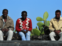 African migrants, who arrived the day before after fleeing Libya on March 28, 2011 rest near the port on the Italian tiny island of Linosa. Three boats laden with hundreds of African migrants, mostly Eritreans, Ethiopians and Somalians, fleeing Libya arrived in Italy, the first such vessels to reach Europe …
