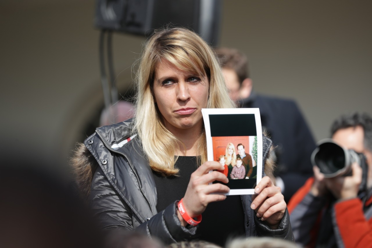 WASHINGTON, DC - FEBRUARY 15: A relative of victim killed by illegal immigrants holds a photo as U.S. President Donald Trump speaks on border security during a Rose Garden event at the White House February 15, 2019 in Washington, DC. President Trump is expected to declare a national emergency to free up federal funding to build a wall along the southern border. (Photo by Chip Somodevilla/Getty Images)