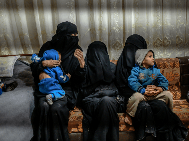 One of the two detained French women who fled the Islamic State group's last pocket in Syria sit with her children while speaking to a AFP reporter at al-Hol camp for displaced people in the al-Hasakeh governorate in northeastern Syria on February 17, 2019. - In the past two months, …