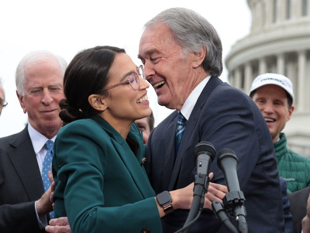 WASHINGTON, DC - FEBRUARY 07: U.S. Rep. Alexandria Ocasio-Cortez (D-NY) (L) and Sen. Ed Markey (D-MA) (R) hug each other as other Congressional Democrats look on during a news conference in front of the U.S. Capitol February 7, 2019 in Washington, DC. Sen. Markey and Rep. Ocasio-Cortez held a news …