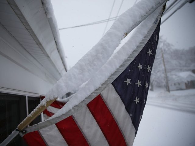 MANCHESTER, NH - FEBRUARY 05: Snow is seen gathered on an American flag during a snow storm as primary voters make up their minds on a Presidential candidate on February 5, 2016 in Manchester, New Hampshire. Democratic and Republican Presidential are stumping for votes throughout New Hampshire leading up to …