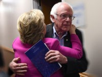 US Democratic presidential nominee Hillary Clinton embraces Bernie Sanders backstage before a campaign rally in Raleigh, North Carolina, on November 3, 2016. / AFP / JEWEL SAMAD (Photo credit should read JEWEL SAMAD/AFP/Getty Images)