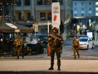 BRUSSELS, BELGIUM - JUNE 20: Armed police stand guard outside Brussels Central train station after a man triggered a small explosion inside the station on June 20, 2017 in Brussels, Belgium. The man was shot by soldiers inside the station and no-one else is believed to have been injured. The …