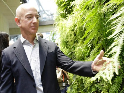 Chief Executive Officer of Amazon, Jeff Bezos, tours the facility at the grand opening of the Amazon Spheres, in Seattle, Washington on January 29, 2018.  Amazon opened its new Seattle office space which looks more like a rainforest. The company created the Spheres Complex to help spark employee creativity. / …