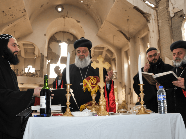 Syriac Orthodox Patriarch of Antioch, Ignatius Aphrem II, holds mass at the heavily damaged Syriac Orthodox church of St. Mary in Syria's eastern city of Deir Ezzor on February 3, 2018. / AFP PHOTO / Ayham al-Mohammad (Photo credit should read AYHAM AL-MOHAMMAD/AFP/Getty Images)