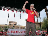 PHOENIX, AZ - APRIL 26: Noah Karvelis, an organizer of the #REDforED movement, speaks during a rally in front of the State Capitol on April 26, 2018 in Phoenix, Arizona. Teachers state-wide staged a walkout strike on Thursday in support of better wages and state funding for public schools. (Photo …