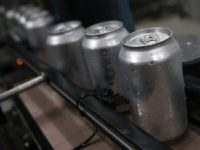 SAN CARLOS, CA - JUNE 06: Freshly canned beers move on an assembly line at Devil's Canyon Brewery on June 6, 2018 in San Carlos, California. New tariffs imposed by U.S. president Donald Trump on aluminum from Canada, Mexico and the European Union could cause the price of canned beer …