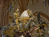"The medieval sculpture ""Saint George and the dragon"" is revealed to the press in the Stockholm cathedral Storkyrkan on April 29, 2010, after a renovation of the whole church prior to the wedding of Swedish Crown Princess Victoria in the cathedral on June 19. AFP PHOTO / Scanpix (Photo credit …"