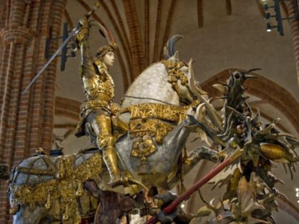 """The medieval sculpture """"Saint George and the dragon"""" is revealed to the press in the Stockholm cathedral Storkyrkan on April 29, 2010, after a renovation of the whole church prior to the wedding of Swedish Crown Princess Victoria in the cathedral on June 19. AFP PHOTO / Scanpix (Photo credit …"""