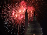 WASHINGTON, DC - JULY 04: The U.S. Capitol and the Washington Monument are seen as fireworks explode above the nation's capital on Independence Day July 4, 2018 in Washington, DC.
