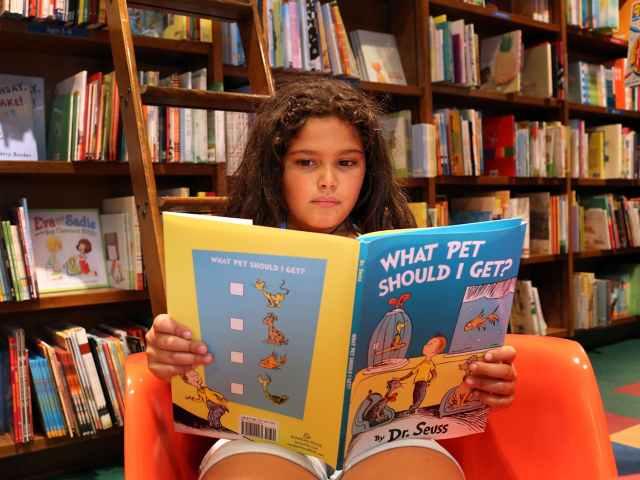 Girl reading Dr  Seuss