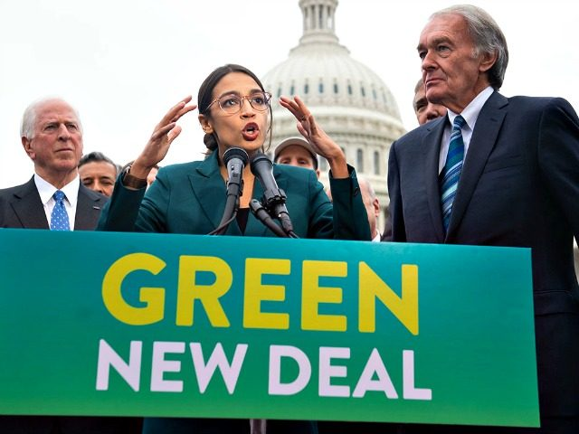 "Rep. Alexandria Ocasio-Cortez and Sen. Ed Markey (right) speak during a press conference to announce Green New Deal legislation on Feb. 7. The resolution was introduced as a ""first step"" to put climate change at the top of Democrats' agenda. 