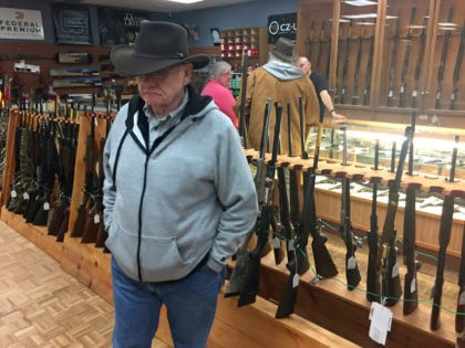 Retired computer programmer and firearms enthusiast Cephas Wright peruses the wares at The Outdoorsman gun shop in Santa Fe, N.M.