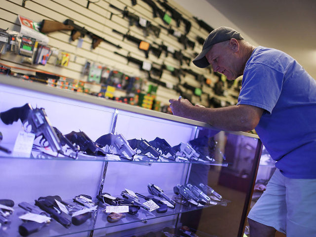 Mark O'Connor fills out his Federal background check paperwork as he purchases a handgun at the K&W Gunworks store on the day that U.S. President Barack Obama in Washington, DC announced his executive action on guns on January 5, 2016 in Delray Beach, Florida.