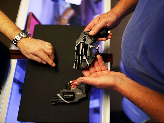 A customer shops for a handgun at the K&W Gunworks store on the day that U.S. President Barack Obama in Washington, DC announced his executive action on guns on January 5, 2016 in Delray Beach, Florida.