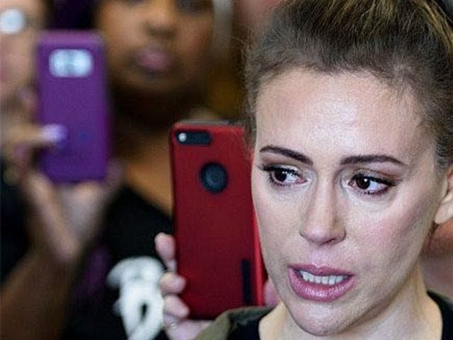 Actress Alyssa Milano gathers with other activists in the office of Senator Susan M. Collins (R-ME) during protests against Judge Brett Kavanaugh on Capitol Hill September 26, 2018 in Washington, DC. - The US Senate Judiciary Committee has scheduled for Friday a preliminary vote on the nomination of Supreme Court …
