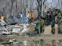 An Indian Air Force officer along with others inspects the wreckage of an Indian aircraft after it crashed in Budgam area, outskirts of Srinagar, Indian controlled Kashmir, Wednesday, Feb.27, 2019. (AP Photo/Mukhtar Khan)