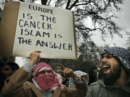 LONDON - FEBRUARY 03: Muslim demonstrators hold banners at the Danish Embassy on February 3, 2006 in London. British muslims have condemned newspaper cartoons which first appeared in a Danish newspaper, some of which depict the Prophet Mohammed wearing a turban shaped like a bomb. The cartoons have sparked worldwide …