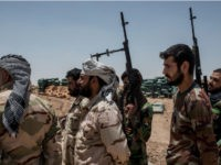 Iraqi PMF fighters June 20, 2017 on the Iraq-Syria border in Nineveh, Iraq.