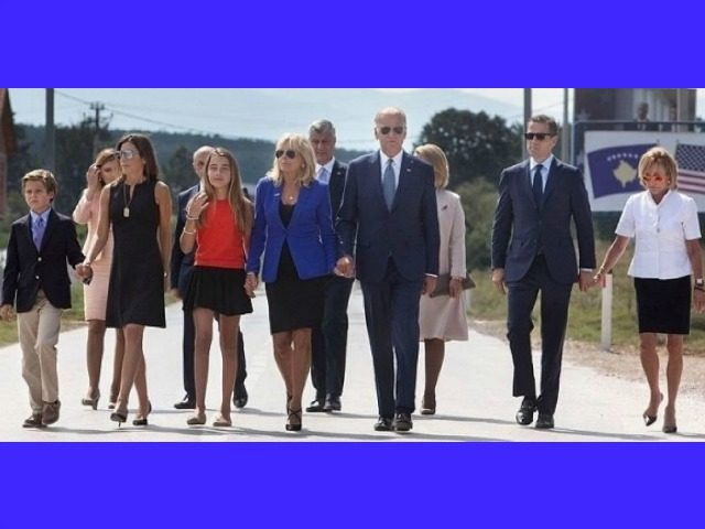 """""""Members of the Biden family cross the highway to a dedication ceremony for a road that was named by the Government of Kosovo in honor of Joseph R. """"Beau"""" Biden, III as a sign of respect and gratitude for Beau's contributions to Kosovo, outside Camp Bondsteel. Pictured (L to R) …"""