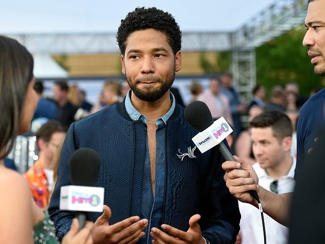 LAS VEGAS, NV - MAY 21: Actor Jussie Smollett (C) is interviewed by SiriusXM hosts Symon (L) and Michael Yo on SiriusXM's 'Hits 1 in Hollywood' on the red carpet leading up to the Billboard Music Awards at the T-Mobile Arena on May 21, 2017 in Las Vegas, Nevada. (Photo …