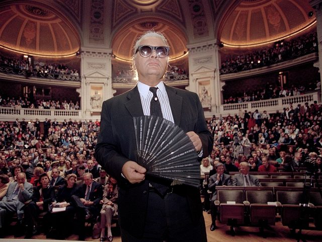 Karl Lagerfeld, the German fashion designer for Chanel, holds his fan as he enters the main auditorium at the Sorbonne, the oldest and most famous university in France, Oct. 18, 1994. Lagerfeld fielded questions from an audience of some 2,000 guests, including Sorbonne students on the Chanel fashion house. (AP …