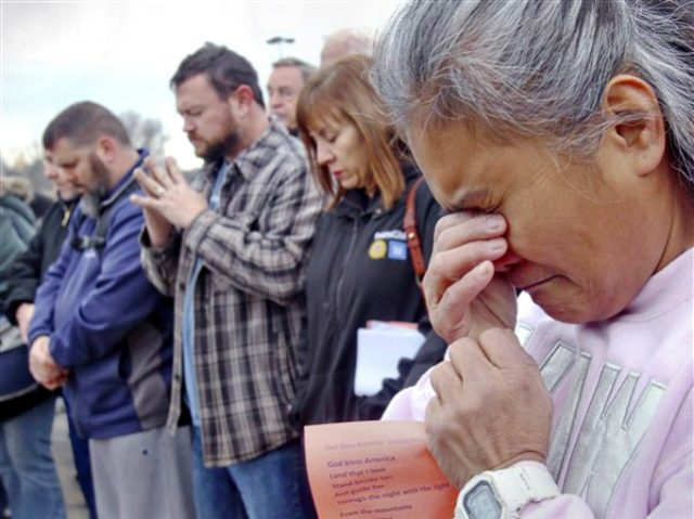 Venus Walker, of Warren, Ohio and a GM employee with 12 years at the Lordstown plant, prays during a vigil outside the Lordstown GM plant, on Nov. 29, 2018.