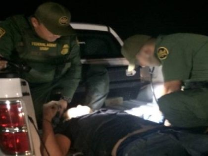 Laredo Sector Border Patrol agents administer medical assistance after rescuing a lost migrant on a ranch near Hebbronville, Texas. (Photo: U.S. Border Patrol/Laredo Sector)