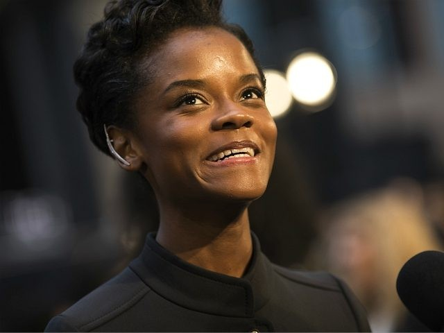 Letitia Wright poses for photographers upon arrival at the Avengers: Infinity War fan event in London, Sunday, April 8, 2018. (Photo by Vianney Le Caer/Invision/AP)