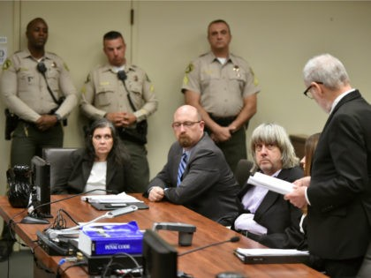 In this Jan. 18, 2018 file photo, Louise Anna Turpin, far left, with attorney Jeff Moore, second from left, and her husband David Allen Turpin, listen to attorney, David Macher, as they appear in court for their arraignment in Riverside, Calif. The community college student with a page-boy haircut was …