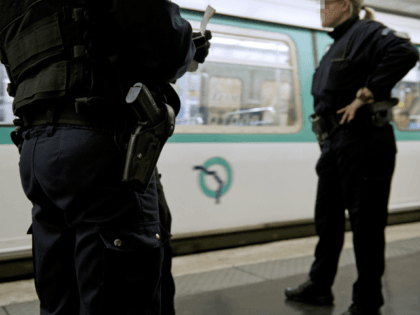 TO GO WITH AFP STORY BY CYRIL TROUAUX Policemen from a brigade in charge of Paris transport network stand on the platform during a patrol in a Paris subway station on April 27, 2014. Policemen focus on offenders known to target sleeping partygoers on their way home at dawn, who …