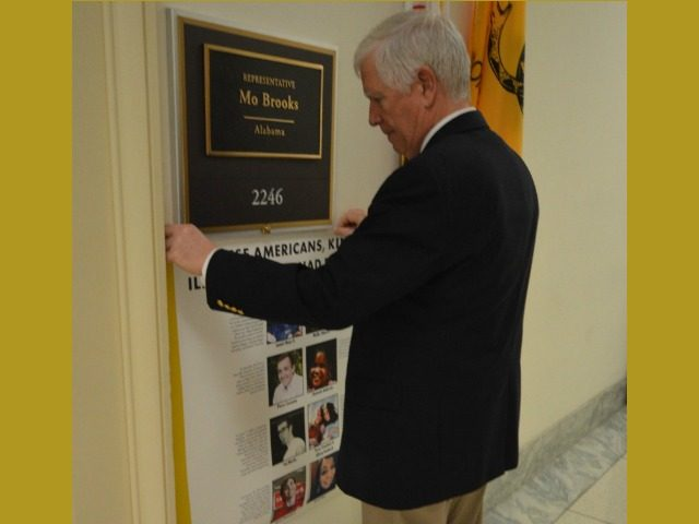 "Congressman Mo Brooks hangs a poster of Americans with dreams, but killed by illegal aliens opposite Rep. Castro illegal alien ""dreamers"" poster (Credit: Office of Congressman Mo Brooks)"