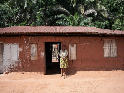 An elderly woman stands outside her house on May 5, 2016 in Nimbo, southeastern Nigeria, where nomadic Fulani herdsman attacked the village. Ongoing clashes between nomadic Fulani herdsmen and farming communities in Nigeria's middle belt and southeast states have accounted for the death and displacement of many people.