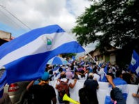 Anti-government protesters take part in a march dubbed 'United Nicaragua will never be defeated' in Granada, Nicaragua on August 25, 2018.
