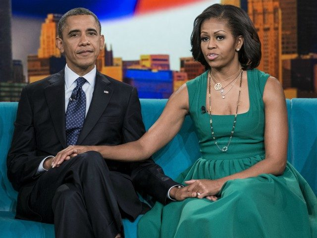 US President Barack Obama and US first lady Michelle Obama sit during a break in a taping of 'The View' at ABC Studios September 24, 2012 in New York, New York. Obama is traveling for a two day trip to New York City where he will participate in a taping …