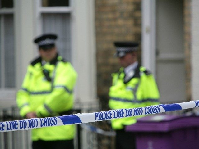 LIVERPOOL, UNITED KINGDOM - JULY 1: Police officers stand outside a house in Hatherley Street, after a raid searching for terror suspects on July 1, 2007 in Liverpool, England. Police launched raids on two properties in Liverpool and Glasgow after making a fifth arrest in connection with the national terrorism …