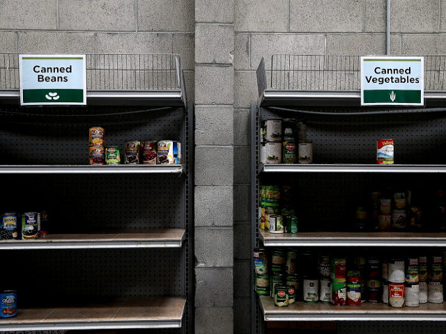 Shelves of canned foods sit partially empty at the SF-Marin Food Bank on May 1, 2014 in San Francisco, California.