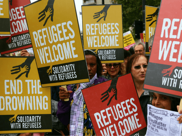Demonstrators gather for a march calling for the British parliament to welcome refugees in the UK in central London on September 17, 2016. Thousands marched in central London calling on the British government to do more to help refugees fleeing conflict and persecution. / AFP PHOTO / Daniel LEAL-OLIVAS (Photo …