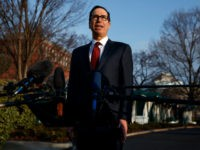 Treasury Secretary Steve Mnuchin speaks with reporters outside the White House, Wednesday, Feb. 6, 2019, in Washington.